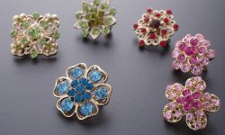set of brooches isolated on black. background of many brooches